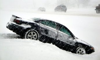 Car stuck in a ditch in the snow