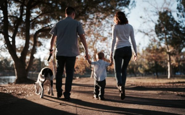 family with dog and young child - should you buy life insurance for children