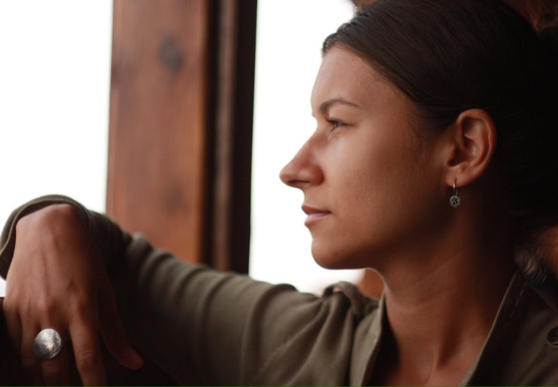 woman thinking - how to raise your credit score