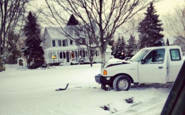 truck crashed into a tree in snow - comprehensive insurance car insurance liability
