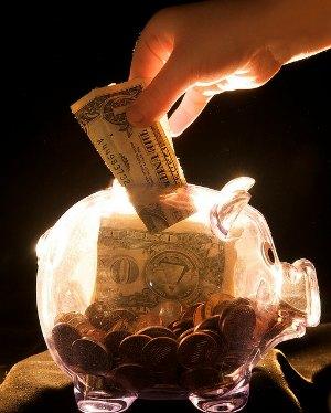 Putting money in a piggy bank