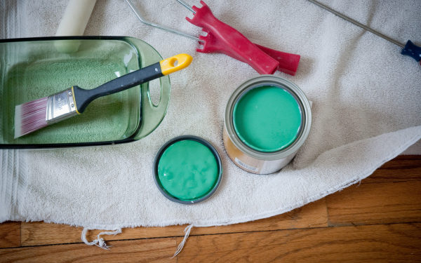 Open can of paint and brushes