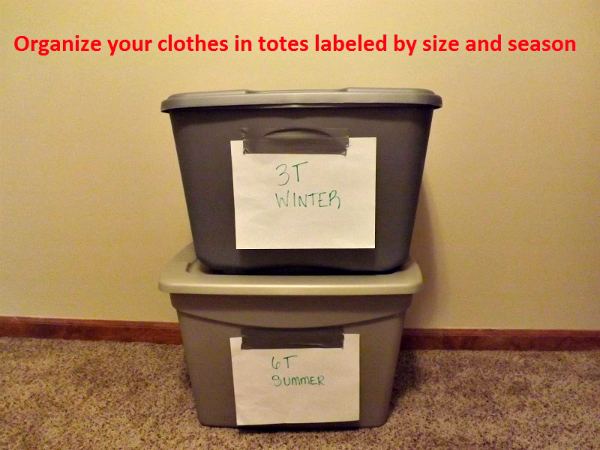 Bins of toddler clothes labeled by age and season