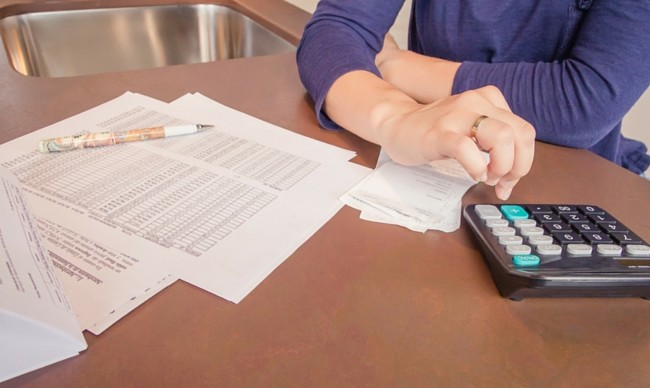 woman reviewing debts and bills