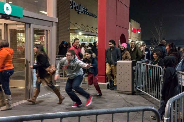 Black Friday crowd swarming store entrance