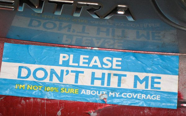 Bumper sticker that reads: Please don't hit me, I 'm not 100% sure about my coverage