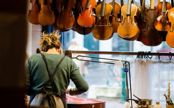 Luthier working on a cello - thoughtful gifts experience gifts and other holiday gift ideas