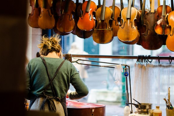 Luthier working on a cello
