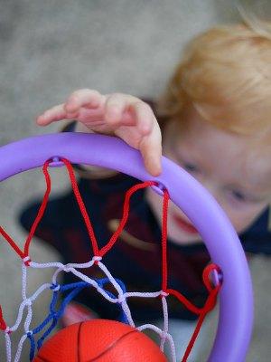 little kid dunking basketball