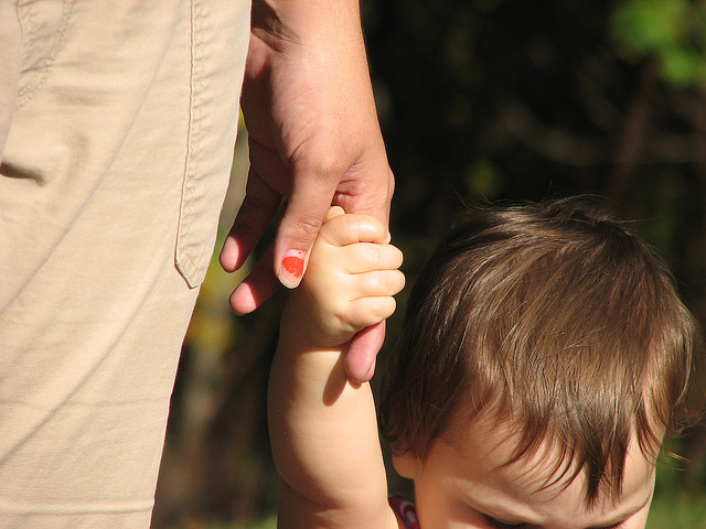 Mom holding child's hand