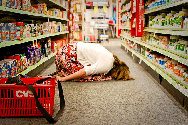 Woman face-down in a CVS aisle