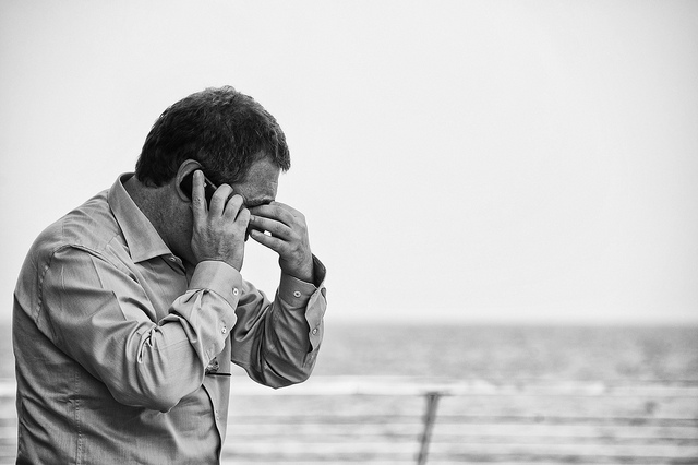 Worried man on cell phone