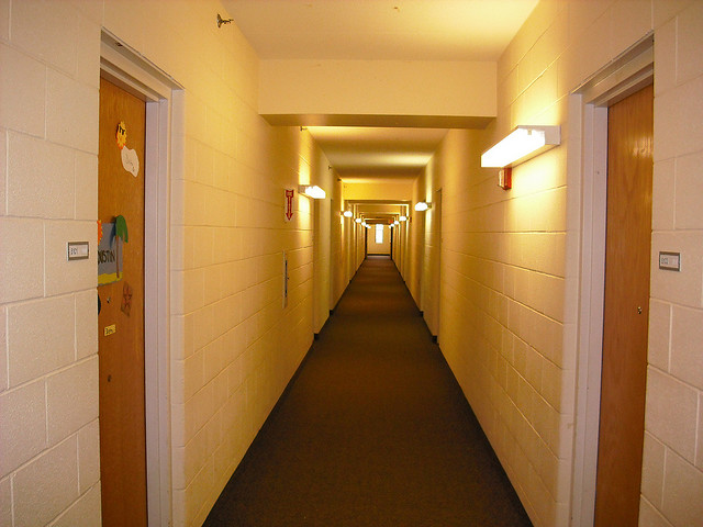 """Photo: You may be expecting to see the twins from """"The Shining,"""" but it's really a dorm hallway. Send your favorite college student back to school with a gift to brighten up institutional living. Qusai Al Shidi"""