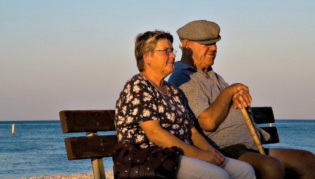 Old couple by the ocean