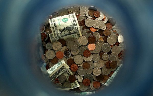 Change jar full of dollars and coins