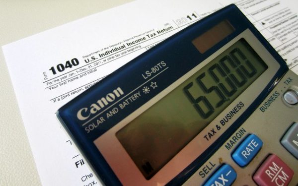 calculator and tax form - federal income tax brackets