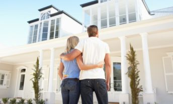 couple looking at nice house