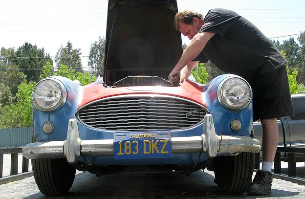 Man working on classic car