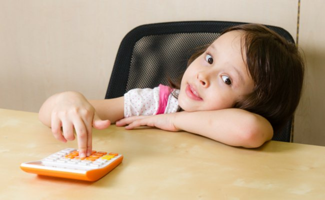 child using a calculator