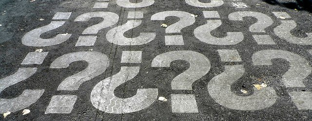 question marks painted on asphalt