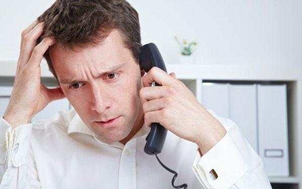 Upset man on the phone