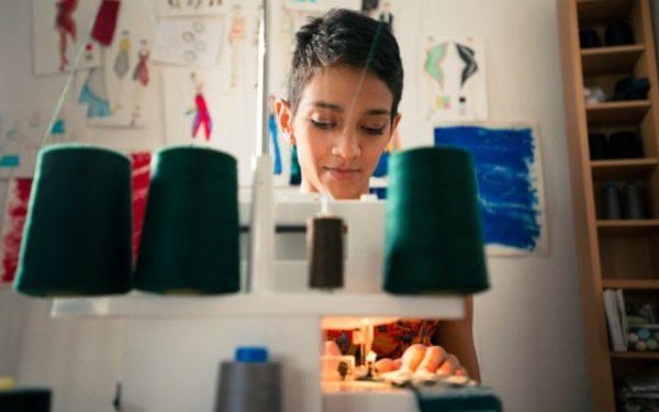 Woman sewing in studio