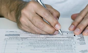 filing out tax form