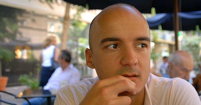 Man thinking at cafe
