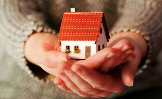 holding a house in hands