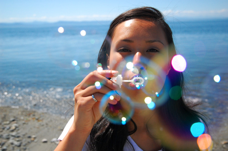 woman blowing bubbles - fun free things to do