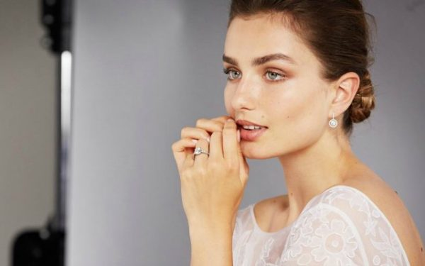 woman modeling engagement ring