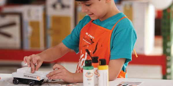 kid doing home depot project