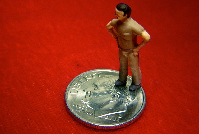 figurine stepping on a dime