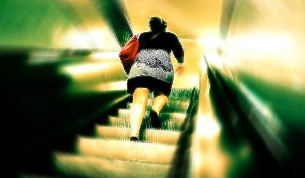 woman climbing subway steps