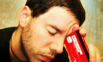 frustrated man with credit card - how to calculate credit card interest