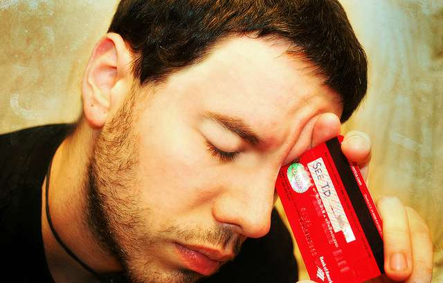 frustrated man with credit card