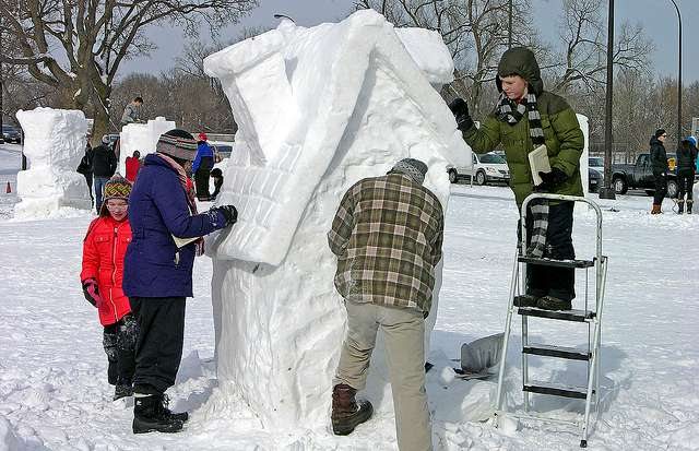 snow sculpture of a house in East Calhoun, Minn.