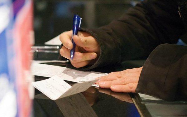 writing a check at the bank