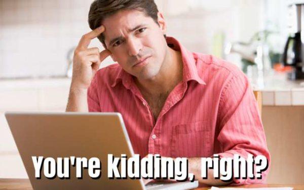 annoyed man on laptop
