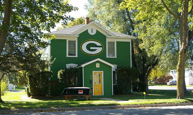 wisconsin homeowners insurance: house with green bay packers logo on it