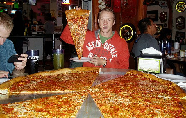 guy eating giant pizza at Big Lou's