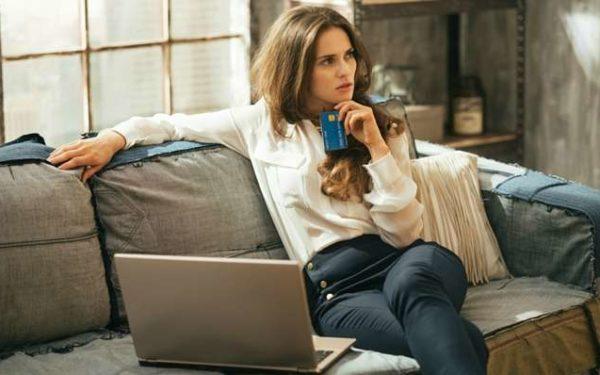 pensive woman shopping online