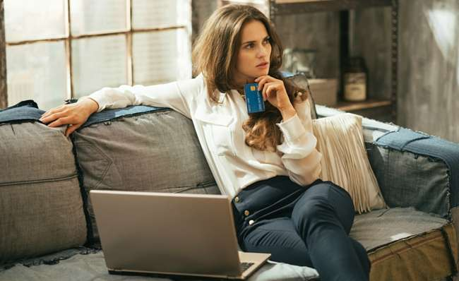 pensive woman shopping online