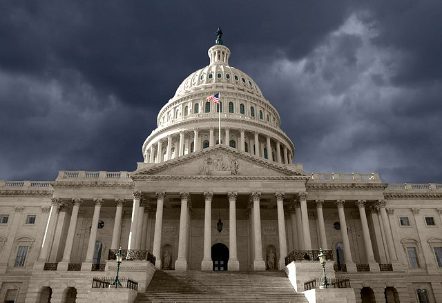 us capitol building with storm clouds overhead