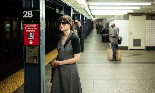 young woman waiting for subway in new york