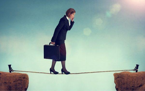 woman walking tightrope - women's retirement gap