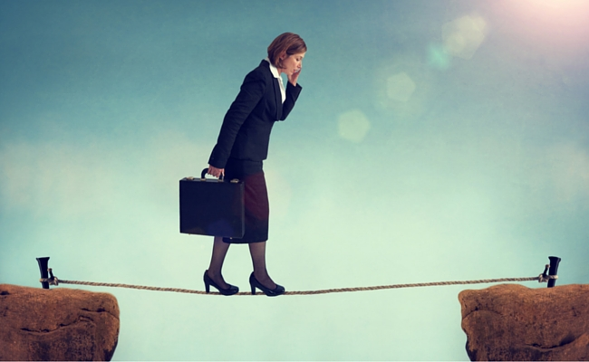 woman walking tightrope - women's retirement gap
