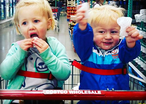 two kids in costco shopping cart