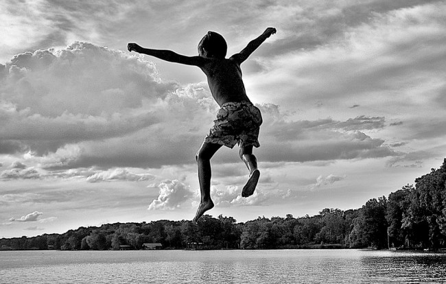 kid jumping into lake