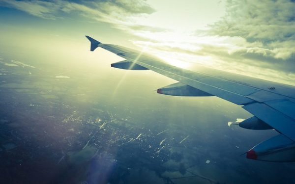airplane window view - cheap flights affordable flights
